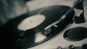 Retro vinyl spinning on turntable, disclosure of secret archival record, closeup. Stock footage stock video