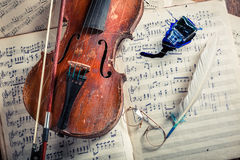 Retro violin and musical sheets with ink and feather Royalty Free Stock Photos
