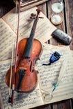 Retro violin and musical sheets Stock Photography