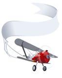 Retro vliegtuig met banner Stock Foto