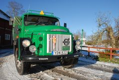 Retro Volvo truck from 1972 on snowy roads. Green Retro veteran Volvo truck N88 from 1972 on snowy winter roads in south of Sweden`s countryside Royalty Free Stock Images