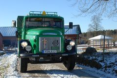 Retro Volvo truck from 1972 on snowy roads. Green Retro veteran Volvo truck N88 from 1972 on snowy winter roads in south of Sweden`s countryside Stock Photography