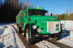Retro Volvo truck from 1972 on snowy roads. Green Retro veteran Volvo truck N88 from 1972 on snowy winter roads in south of Sweden`s countryside Stock Image