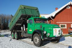 Retro Volvo truck from 1972 on snowy roads stock images