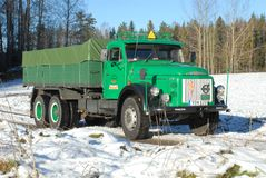 Retro Volvo truck from 1972 on snowy roads. Green Retro veteran Volvo truck N88 from 1972 on snowy winter roads in south of Sweden`s countryside Royalty Free Stock Photography