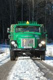 Retro Volvo truck from 1972 on snowy roads. Green Retro veteran Volvo truck N88 from 1972 on snowy winter roads in south of Sweden`s countryside Stock Photos