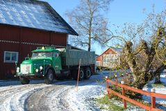 Retro Volvo truck from 1972 on snowy roads. Green Retro veteran Volvo truck N88 from 1972 on snowy winter roads in south of Sweden`s countryside Royalty Free Stock Photos