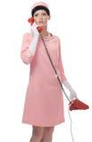 Retro vrouw in roze kledingsjaren '60 Royalty-vrije Stock Foto's