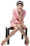 Retro vrouw in roze kledingsjaren '60 Stock Fotografie