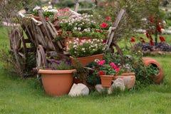 Retro wain in a garden. Retro wain with flowers in a garden Royalty Free Stock Photos