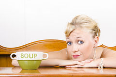 Retro waiter with soup bowl at restaurant counter Stock Photo