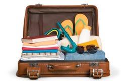 Retro walizka z podróżą protestuje na drewnianej desce Zdjęcie Royalty Free