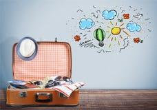 Retro walizka z podróżą protestuje na drewnianej podłoga Obraz Royalty Free