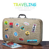 Retro walizka z stikkers na podłoga Obrazy Royalty Free