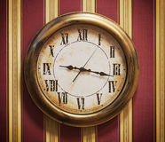 Retro wall clock and striped wallpaper Stock Photo