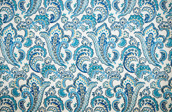 Retro wall decoration background. Retro texture of wallpaper with blue vintage floral designs Royalty Free Stock Photo