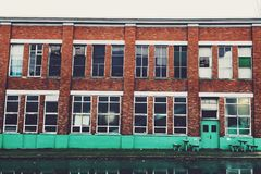 Retro warehouse building on a rainy day Stock Images