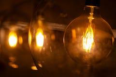 Retro warm light bulbs in glass lamps. Retro warm light bulbs in glass lamps - shallow depth of field stock photography