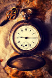 Retro watch. Retro pocket watch on the paper.selective focus in the middle of pocket watch Royalty Free Stock Photo