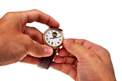 Retro watch in male hands. Retro watch in male hands isolated over white background Stock Images