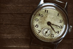 Retro watch. On wood table Royalty Free Stock Photo