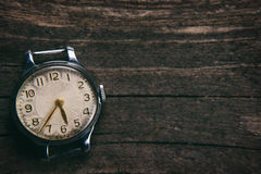 Retro watch. On a wooden background Royalty Free Stock Image