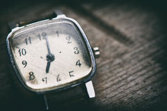 Retro watch. On a wooden background Royalty Free Stock Photography
