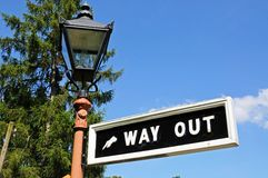 Retro way out sign and lamppost. Stock Photo
