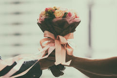 Retro wedding bouquet with the flower in hands Stock Photos