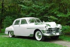 Retro wedding car. In the park stock photos
