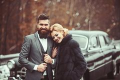 A retro wedding car with just married couple in love. royalty free stock image
