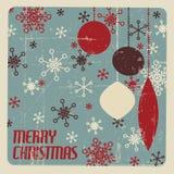 Retro- Weihnachtskarte mit Weihnachtsdekorationen Stockfotografie