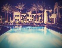 Retro- Weinlese stylepicture des Pools nachts lizenzfreies stockfoto