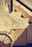 Retro wheel bicycle detail and old stairs. Vintage style. Royalty Free Stock Photo