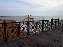 Retro wheel on the pier royalty free stock photo