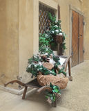 Retro wheelbarrow with Christmas decorations Royalty Free Stock Image