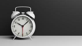Retro white alarm clock on tabletop Stock Image
