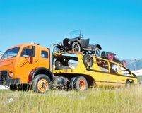 Retro white 3000 flatbed car hauler. In the middle of 20 century on the roads of America was very popular White 3000 car hauler ,now it  is  antique exhibit Stock Photography