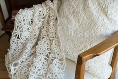 White knitted cover on the chair. retro royalty free stock photo