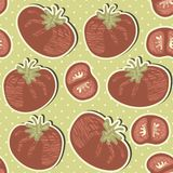 Retro whole tomatoes and slices on polka dots on g Stock Photography