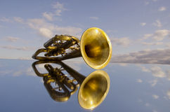 Retro wind instrument on mirror Stock Photography