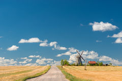 Retro windmill in a field Royalty Free Stock Images