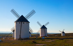 Retro windmills in field Stock Photography