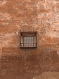 Retro window. The wall with small prisoner window in retro style Royalty Free Stock Image