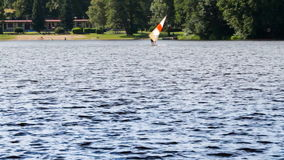 Retro windsurfing on the pond or lake. Old shool sport action. stock video