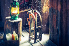 Retro winter cottage with small wooden sleigh Stock Photo