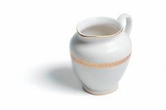 Retro witte kruik van de porseleinmelk Stock Foto