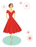Retro woman. Smiling retro woman in flared red dress Royalty Free Stock Image