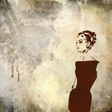 Retro woman. Woman  in black dress on grunge background Stock Image