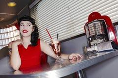 Retro Woman In American Diner Stock Photo